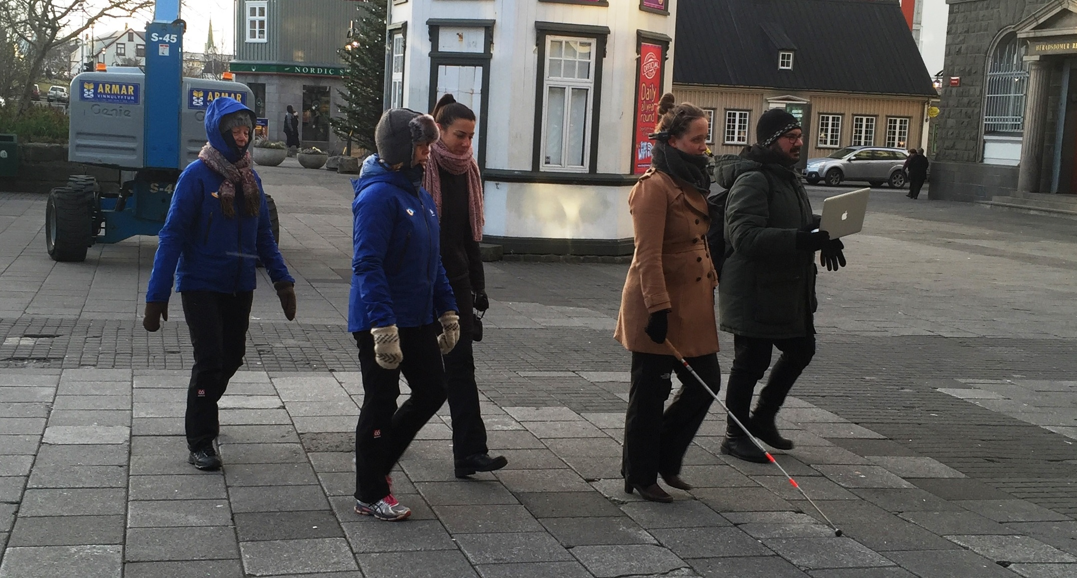A group of participants navigating the city as part of an outdoor mobility study